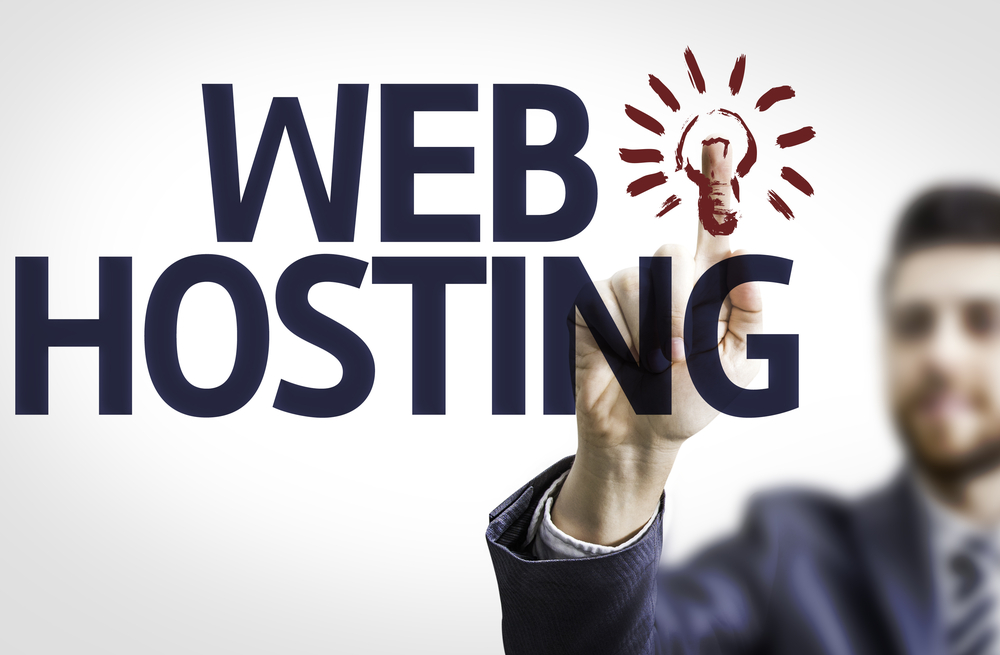Business man pointing to transparent board with text Web Hosting
